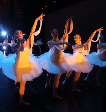 Exeter students performing ballet on the stage