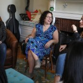 Jennifer Marx Asch in her dorm living room surrounded by students.