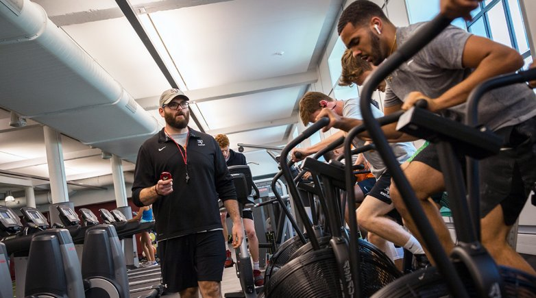 Shaun Fishel works with students in the Downer Fitness Center at Exeter.