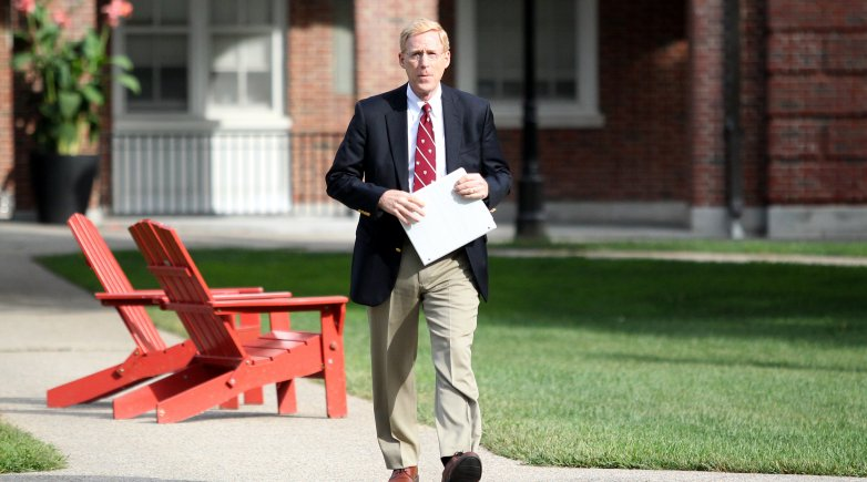 Principal Bill Rawson walking along a path on Exeter's campus.